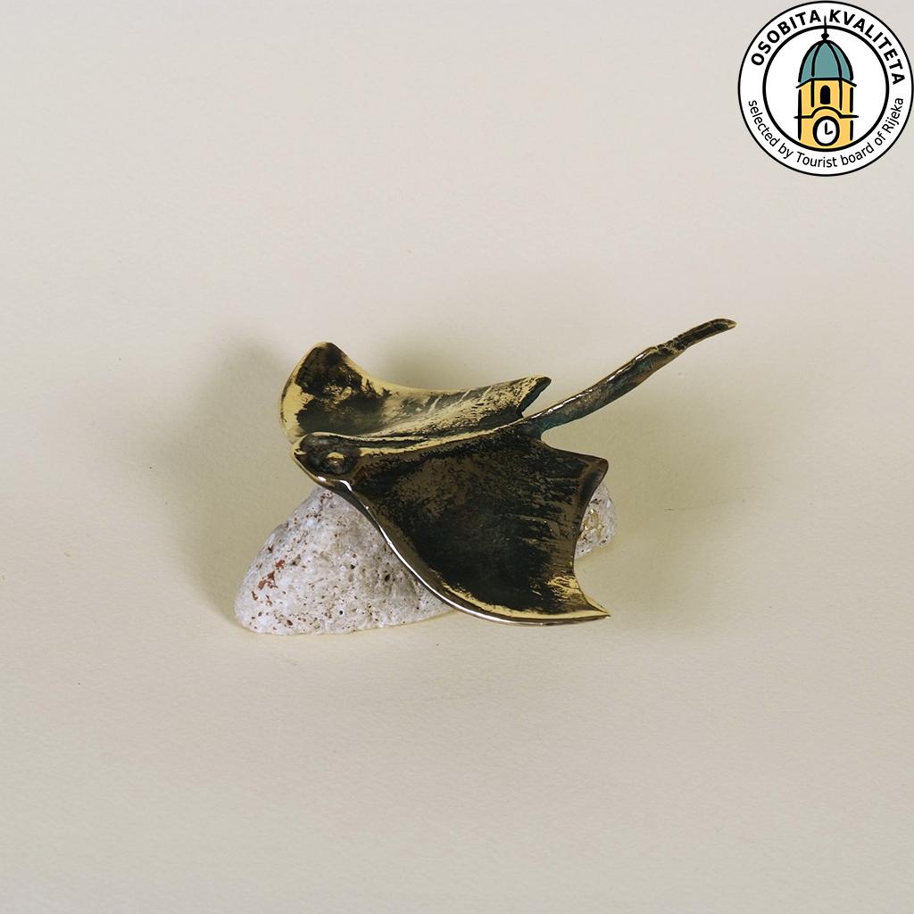 RAZZA/grotta sulla spiaggia – bronzo/